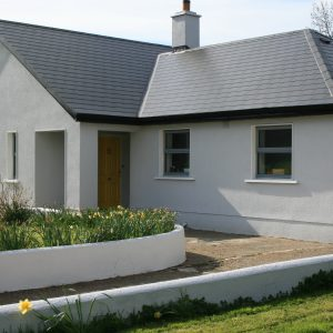 House painted with Atlantic Grey masonry paint