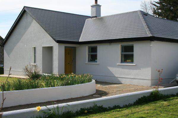 House painted with Atlantic Grey masonry paint